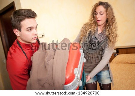 Bellhop Moving Heavy Luggage,Italy - stock photo