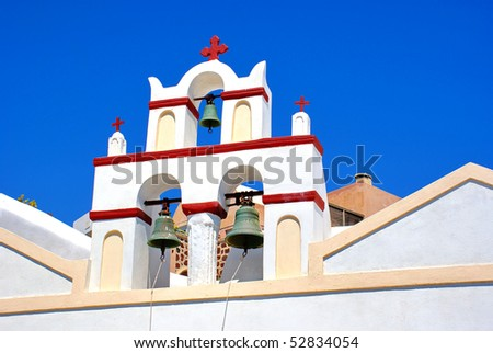Bells and blue sea, Greece - stock photo