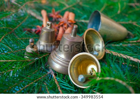 bells,christmas time,marry christmas,green background,badian,needle - stock photo