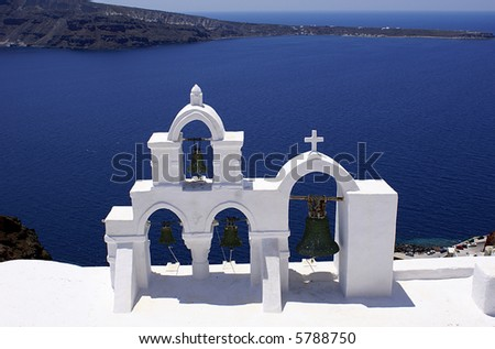 Bells of church on Santorini island, Greece - stock photo
