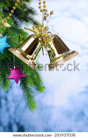 Bells with Christmas decoration on light background - stock photo