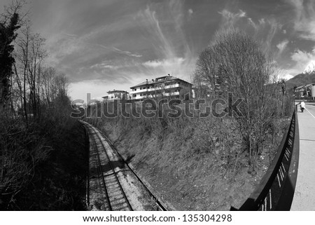 Belluno, Dolomites: railway with dramatic sky - stock photo