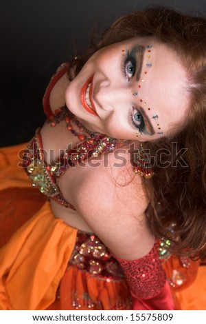 Belly Dancer wearing a red costume with jewelery