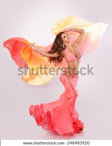 Belly dancer woman Arabian beauty, oriental dancer woman, long curly hair brunette woman, indian girl, bellydance, studio isolated. series - stock photo