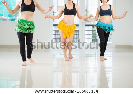 Belly dancers shaking their hips while performing in the dance hall - stock photo