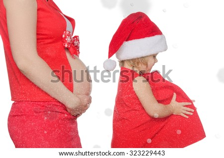 belly of pregnant woman and child on Christmas and snowflakes