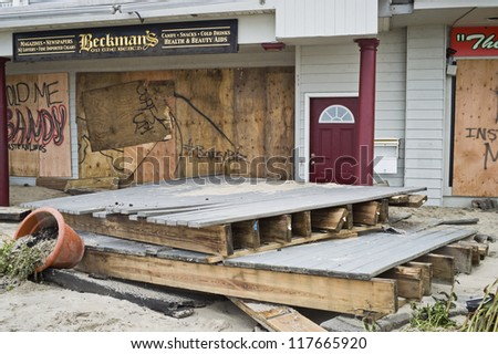 BELMAR, NEW JERSEY/USA-Â?Â? OCTOBER 30: Damaged store fronts along Ocean Ave the day after Hurricane Sandy on October 30, 2012 in Belmar New Jersey. - stock photo