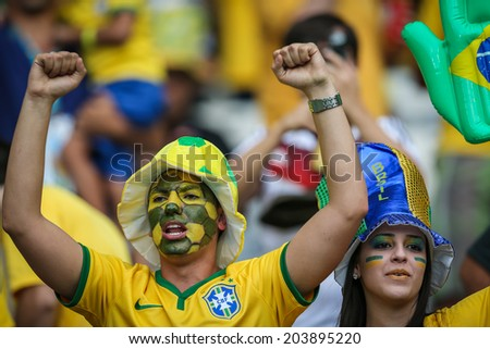 BELO HORIZONTE, BRAZIL - July 8, 2014: Brazil soccer fans celebrating at the 2014 World Cup Semi-finals game between Brazil and Germany at Mineirao Stadium. NO USE IN BRAZIL.