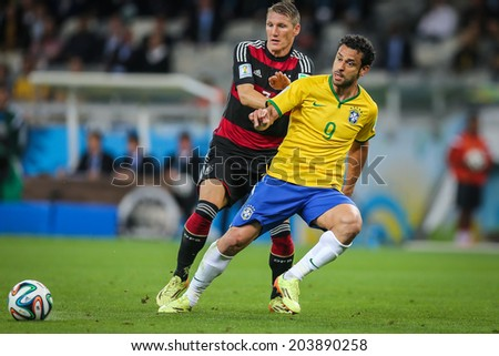 BELO HORIZONTE, BRAZIL - July 8, 2014: Fred of Brazil competes for the ball during the World Cup Semi-Final match against Germany at Mineirao Stadium. NO USE IN BRAZIL.