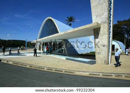 BELO HORIZONTE, BRAZIL - JULY 22: Tourists walk outside the church of Sao Francisco de Assis July 22, 2005 in Belo Horizonte, Brazil. Built by Oscar Niemeyer it is also known as the Church of Pampulha. - stock photo