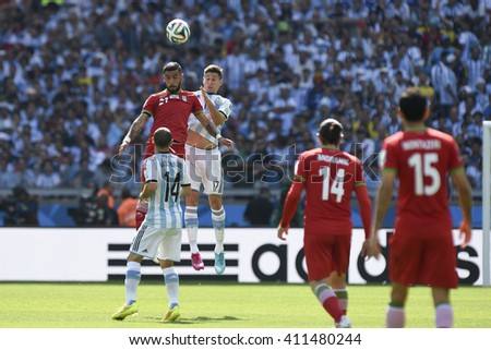 Belo Horizonte, Brazil - June 21, 2014: Ashkan DEJAGAH of Iran and Federico FERNANDEZ of Argentina during the FIFA 2014 World Cup. Argentina is facing Iran in the Group F at Minerao Stadium