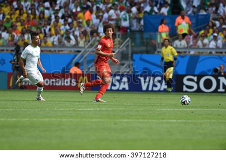 BELO HORIZONTE, BRAZIL - June 17, 2014: Axel WITSEL of Belgium compete for the ball during the World Cup Group H game between Belgium and Algeria at Mineirao Stadium.