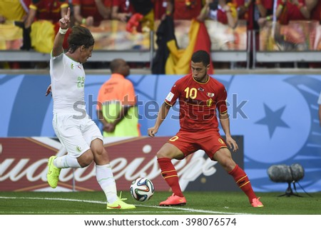 BELO HORIZONTE, BRAZIL - June 17, 2014: Eden HAZARD of Belgium, compete for the ball during the World Cup Group H game between Belgium and Algeria at Mineirao Stadium. - stock photo