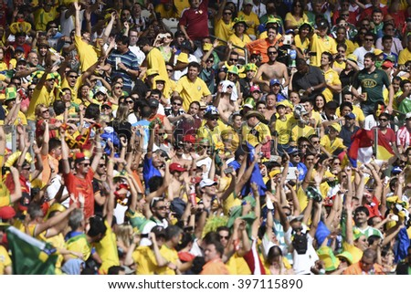 BELO HORIZONTE, BRAZIL - June 17, 2014: Fans  during the World Cup Group H game between Belgium and Algeria at Mineirao Stadium.  - stock photo