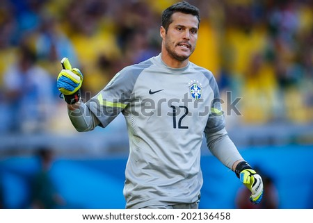 BELO HORIZONTE, BRAZIL - June 28, 2014: Goalkeeper Julio Cesar of Brazil during the penalty kicks at the 2014 World Cup Round of 16 game between Brazil and Chile at Mineirao Stadium. No Use in Brazil. - stock photo