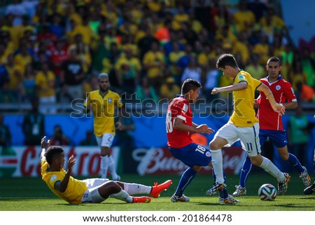 BELO HORIZONTE, BRAZIL - June 28, 2014: Jara of Chile competes for the ball during the 2014 World Cup Round of 16 game between Brazil and Chile at Mineirao Stadium. No Use in Brazil.