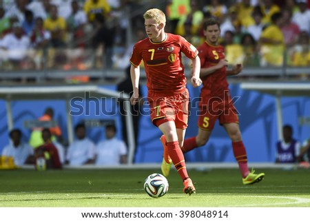 BELO HORIZONTE, BRAZIL - June 17, 2014: Kevin DE BRUYNE of Belgium compete for the ball during the World Cup Group H game between Belgium and Algeria at Mineirao Stadium. - stock photo