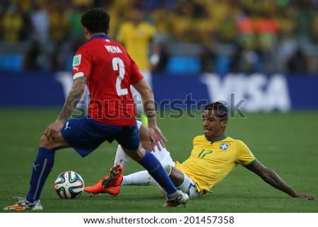 BELO HORIZONTE, BRAZIL - June 28, 2014: Luiz Gustavo and Mena at the 2014 World Cup Round of 16 game between Brazil and Chile at Mineirao Stadium. No Use in Brazil.
