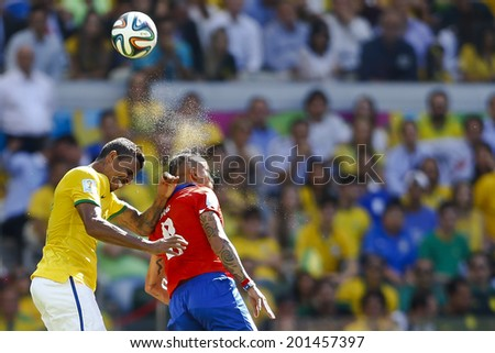 BELO HORIZONTE, BRAZIL - June 28, 2014: Luz Gustavo and Arturo Vidal at the 2014 World Cup Round of 16 game between Brazil and Chile at Mineirao Stadium. No Use in Brazil.