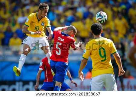 BELO HORIZONTE, BRAZIL - June 28, 2014: Neymar of Brazil competes for the ball during the World Cup Round of 16 game between Brazil and Chile at Mineirao Stadium. No Use in Brazil.