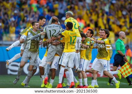 BELO HORIZONTE, BRAZIL - June 28, 2014: Players of Brazil celebrate after winning on penalty kicks during the 2014 World Cup Round of 16 game against Chile at Mineirao Stadium. No Use in Brazil.