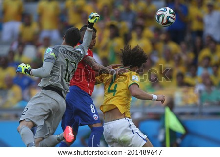 BELO HORIZONTE, BRAZIL - June 28, 2014: Vidal of Chile and Julio Cesar, David Luiz of Brazil during the 2014 World Cup Round of 16 game between Brazil and Chile at Mineirao Stadium. No Use in Brazil.