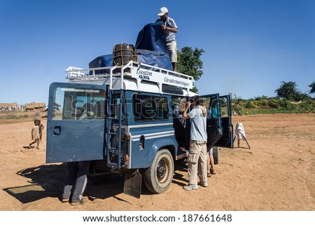 BELO SUR TSIRIBIHINA, MADAGASCAR, JUL 3:  Unidentified tourists with a all-terrain vehicle from transport in the bush of Madagascar on jul 3, 2006 - stock photo