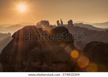 Belogradchik rocks.  Magnificent sunset view of the Belogradchik rocks in Bulgaria, lit by the last rays of the sun. - stock photo
