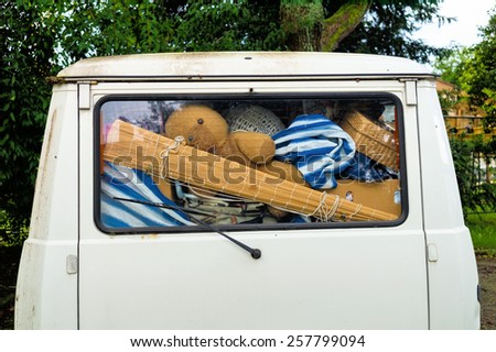 belongings in a van, symbolic photo for relocation and holidays - stock photo