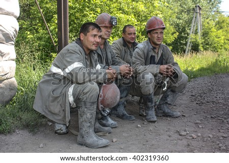 BELOVO, RUSSIA JULY 17, 2015: Miners working in anticipation of transport, before sending on change