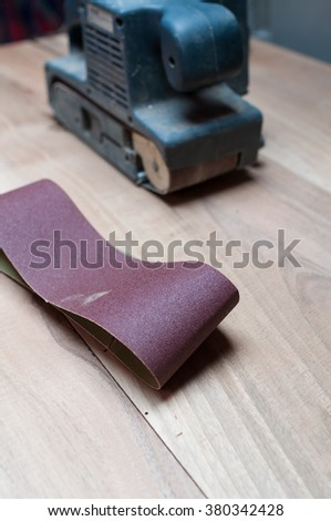 Belt sand on wooden background, wood tools - stock photo