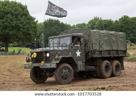 BELTRING, UK - JULY 26: A modern era US army supply truck parades around the main arena for the public to watch at the War & Peace Revival show on July 26, 2017 in Beltring