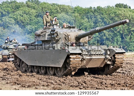 BELTRING, UK - JULY 19: A preserved ex-British army Centurion tank negotiates a rutted and muddy circuit in the parade ground at the War & Peace show on July 19, 2012 in Beltring