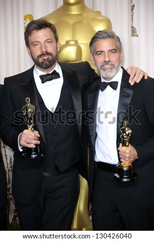 Ben Affleck and George Clooney at the 85th Annual Academy Awards Press Room, Dolby Theater, Hollywood, CA 02-24-13 - stock photo