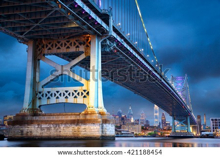Ben Franklin Bridge above Philadelphia skyline at dusk, US - stock photo