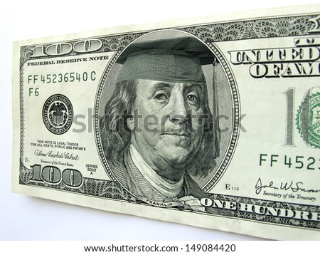 Ben Franklin wears a cap and tassel on this one hundred dollar bill possibly illustrating the high cost of a college education, the importance of graduation, or the investment in a college loan.