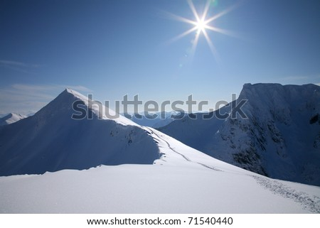Ben Nevis, seen from Carn Mor Dearg in winter, Scotland. - stock photo