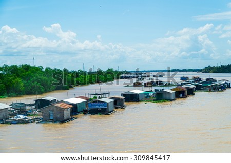 Ben Tre, Vietnam - August 11, 2015: floating homes on the Tien Giang River in the province of Ben Tre, in the Mekong Delta region of southern Vietnam.