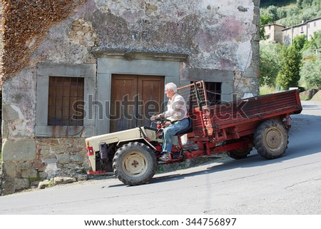 Benabbio, Italy-June 4, 2015. Local villager drving a tractor through the narrow and winding streets of Benabbio, Italy
