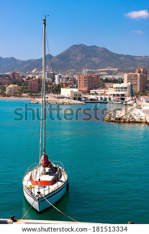 Benalmadena in Spain, sailboat with lowered sails  - stock photo