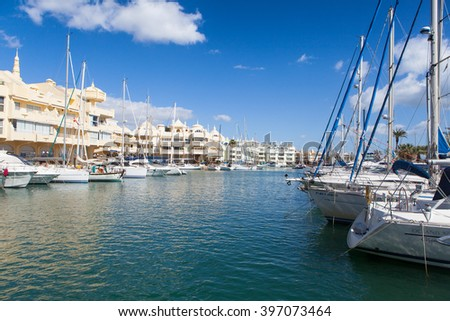 BENALMADENA, SPAIN - MARCH 5, 2016: Docked boats at Puerto Marina harbor in Benalmadena, Spain. Puerto Marina is one of the biggest leisure ports in Andalusia, and is located at Costa del Sol. - stock photo