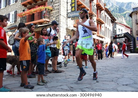 Benasque, Spain - July 26th of 2015: Trail runners pushing hard on their final rush to reach the finish line during one of the five races of the Gran Trail Aneto Posets (GTAP) of 2015.