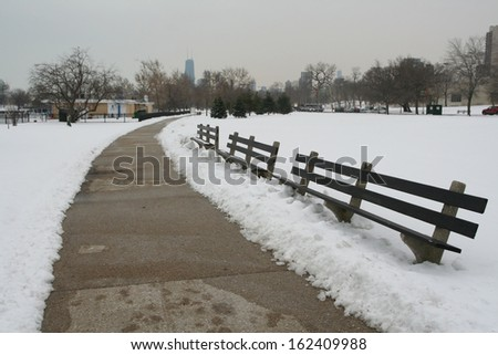bench and footpath with snowy on christmas time in Chicago, IL, USA - stock photo