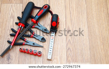 Bench and mounting tools on a wooden background - stock photo