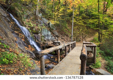 Bench and place to rest at Juney Whank Falls in North Carolina - stock photo
