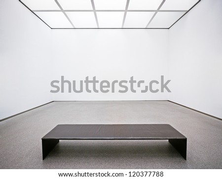 bench at a gallery in berlin (germany) - nice background with space for text - stock photo