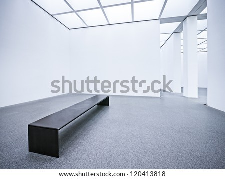 bench at an empty gallery- nice background - stock photo