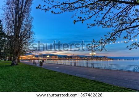 Bench at the english garden promenade near the lake by night, Geneva, Switzerland, HDR - stock photo