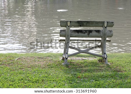 Bench beside lake in the park.