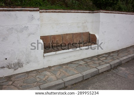 Bench built into a wall , Spain - stock photo